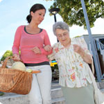 A carer helps her loved one with shopping.