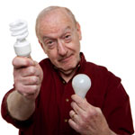 A older man chooses an energy efficient bulb.