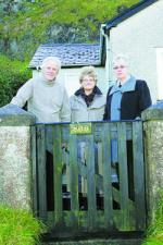 A photograph of John McCarter, Pat Lee (Age Concern Causeway) and Commisioner Claire Keatinge