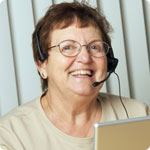 An older woman working as a telephonist.